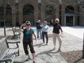 Area residents enjoy an Evergreen Forum tai chi course.