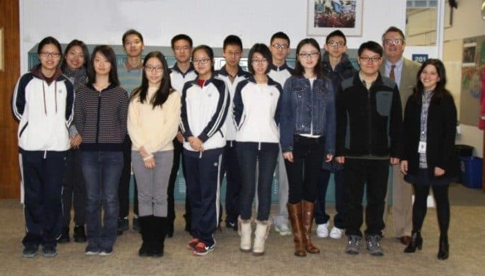 Princeton Day School welcomed 12 students from Beijing High School No. 4 on Tuesday. Pictured are students, their program leader, Head of School Paul Stellato (second from right) and teacher Maria Shepard (far right).