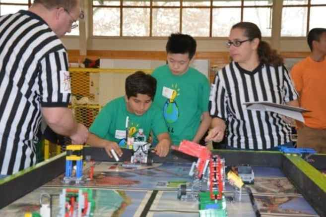 PDS students Neel Adusumilli of Skillman and Will Sun of Basking Ridge take part in the Lego League competition.