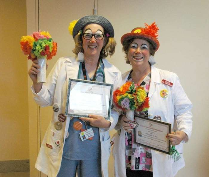 Retired teacher Linda Kreshover (aka Dr. Hedda Class) of Langhorne, Pa. (l) and realtor Helene Rubin (aka Dr. Apple A. Day) of Langhorne, Pa. (r) celebrate their their graduation into the therapeutic clown program at Capital Health Medical Center.