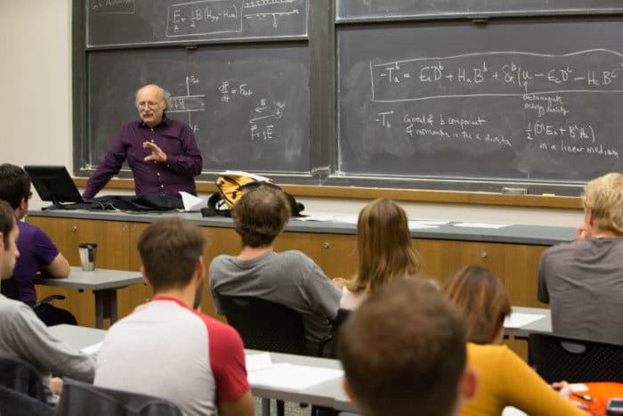 """Haldane in Princeton's Jadwin Hall Tuesday morning teaching his first class as a Nobel Laureate, """"Electromagnetism: Principles and Problem Solving."""" As Haldane entered the room, his students erupted in applause and cheers. Photo: Princeton University, Office of Communications, Denise Applewhite."""