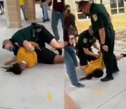 [:en]Outta Pocket: Police Officer Body Slams A Female High School Student While Attempting To Stop A Fight![:]