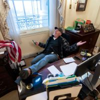 Protester Invaded The US Capital And Sat At House Speaker Nancy Pelosi's Desk!