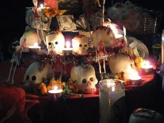 Sugar skulls adorn an ofrenda. Photo taken at the Dia de los Muertos Celebration at Union Plaza, El Paso, Texas, November 2, 2007. Photographer unknown.