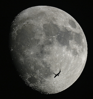 A passenger aircraft is captured against the Moon in 2006, above Tycho, the well-known landmark crater of the southern lunar hemisphere. Photo by Anthony Ayiomamitis.