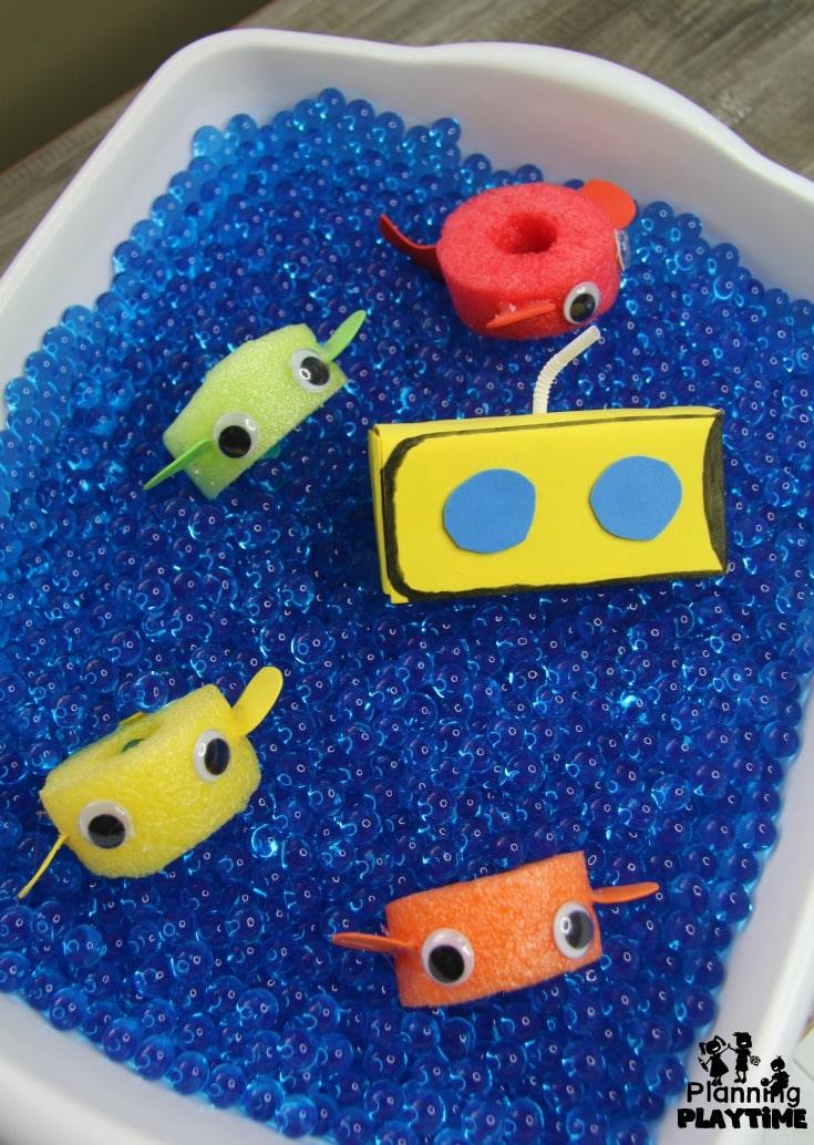 Ocean Sensory Bin with a Juice box Submarine and Pool Noodle Fish #preschool #dramaticplay #underthesea #oceantheme #sensoryplay #sensorybin