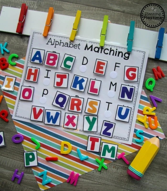 alphabet activity page with velcro dots and colored alphabet squares to match and attach