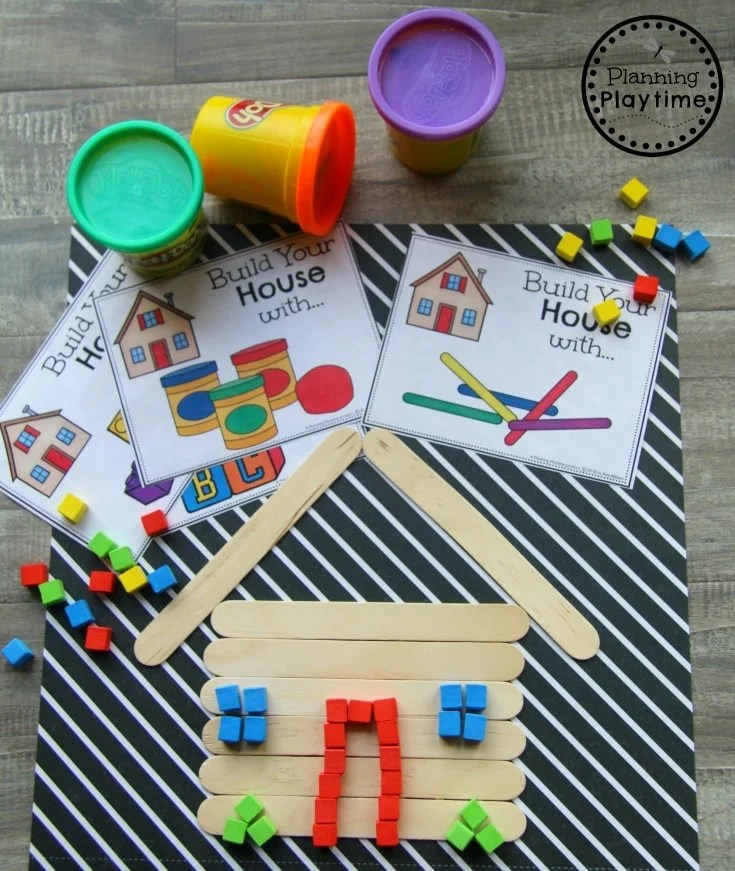 cards with stem projects. A house built with craft sticks and mini blocks