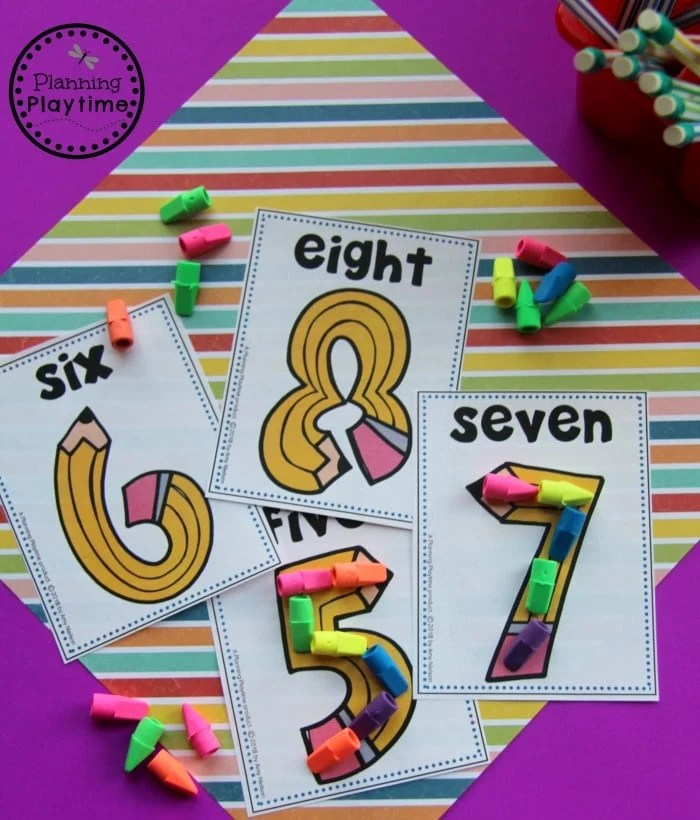 Pencil shaped number cards. Erasers used to outline the numbers
