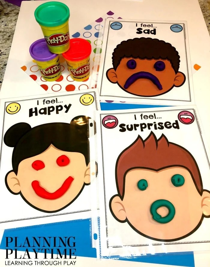 Printables with blank faces - Playdough used to make the faces.