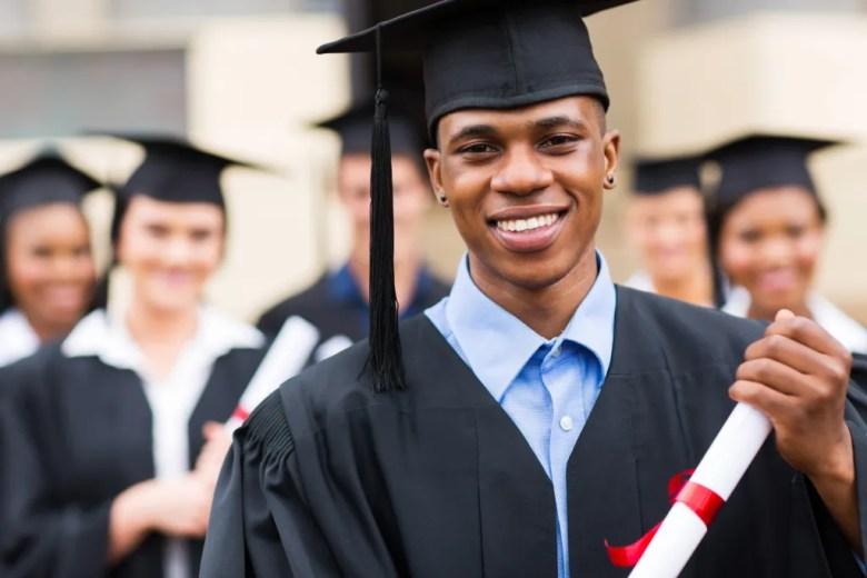 graduate multicultural boy diploma