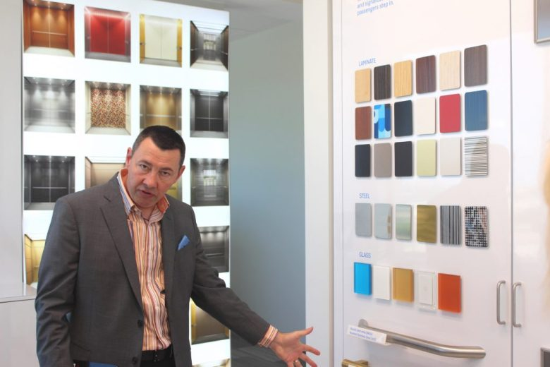 Patrick O'Connell, Director of Marketing at KONE, shows KONE elevator design choices.