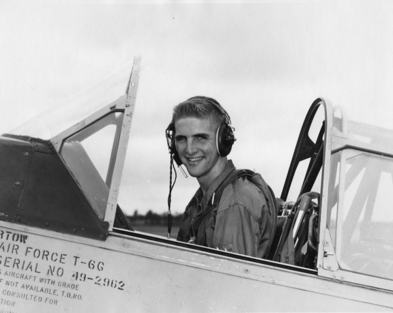 Congressman Sam Johnson sits in a T-6 Texan