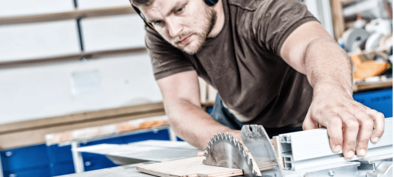 Woodworking Man using bench saw