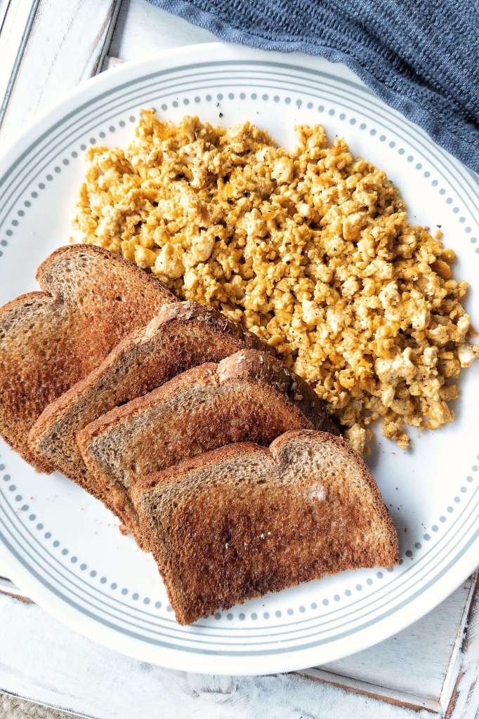 Plate of basic tofu scramble with a side of 4 pieces of toast