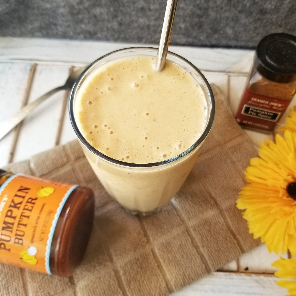 Pumpkin smoothie in a tall, clear glass