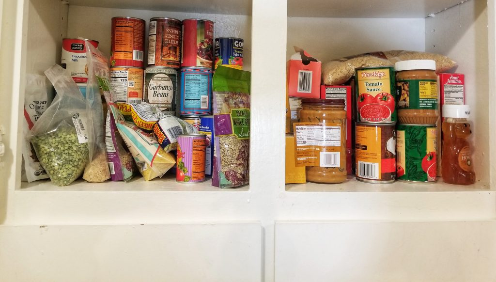 Canned and packaged food in a kitchen pantry