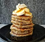 Stack of oat bran pancakes with bananas