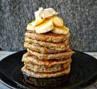 Stack of oat bran pancakes with bananas