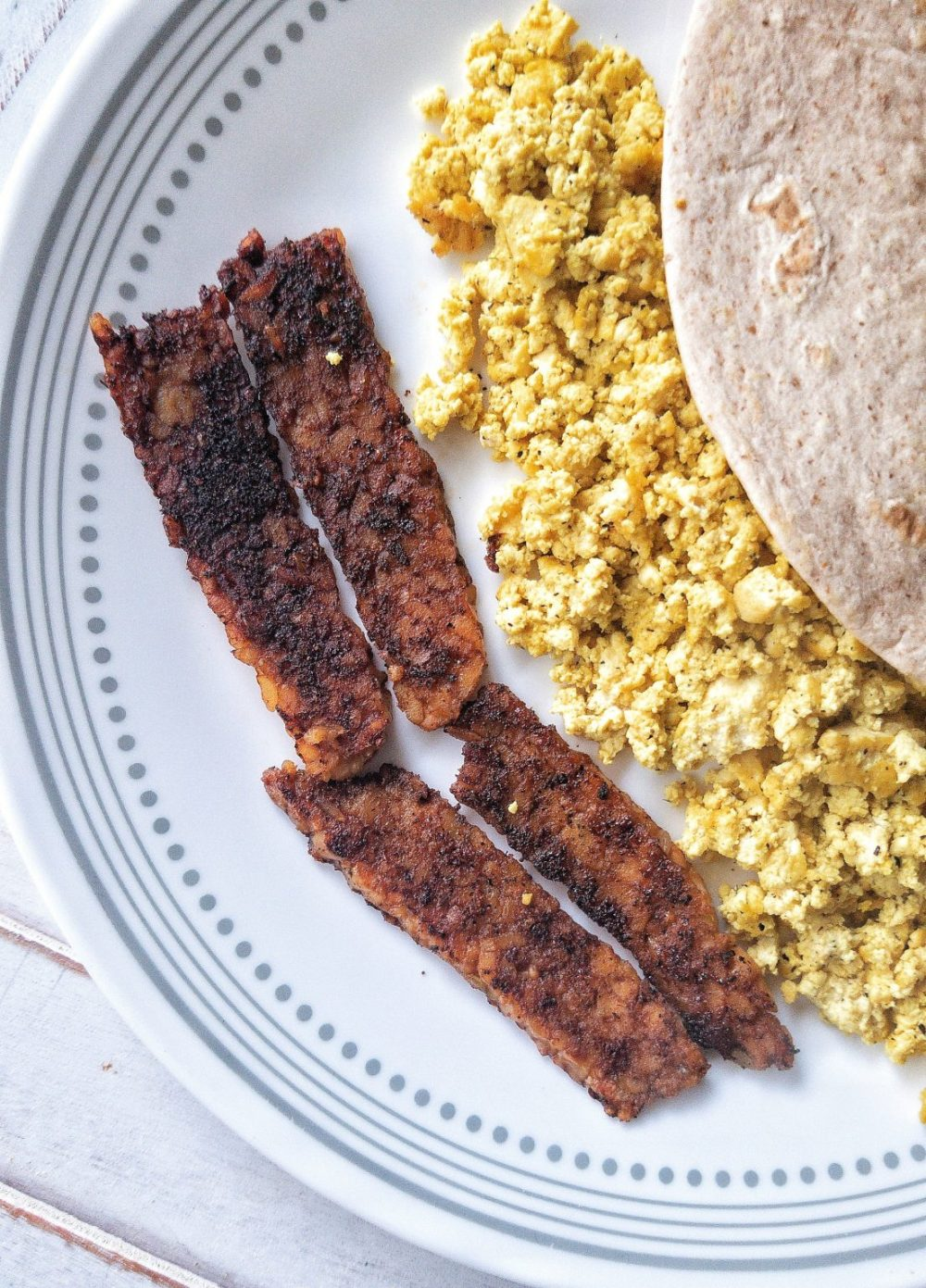 Smoky tempeh bacon with a side of tofu scramble