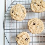 Chewy, soft chocolate chip cookies on a cooling rack