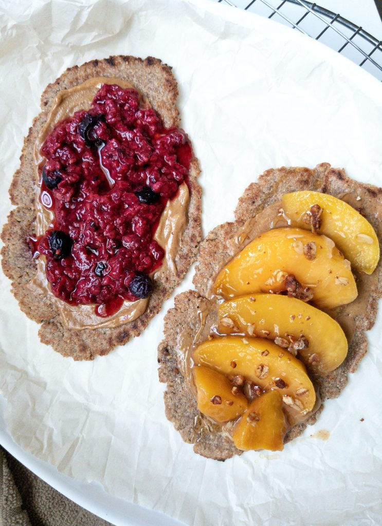 Cinnamon brown sugar flatbread. One flatbread topped with mixed berries and the other with ripe peaches, granola, and honey