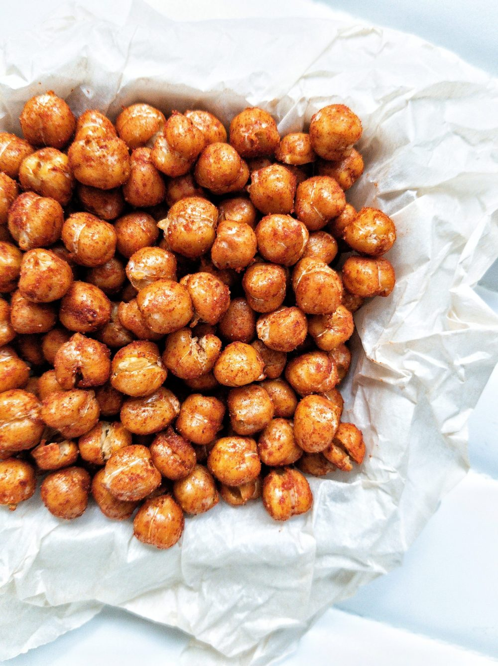 Roasted chickpeas with smoked paprika on top of parchment paper