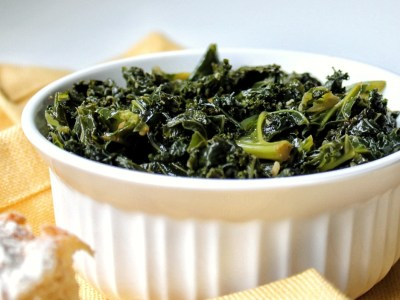 Braised kale in a white bowl