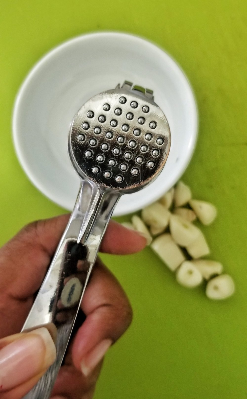 Close-up garlic presser