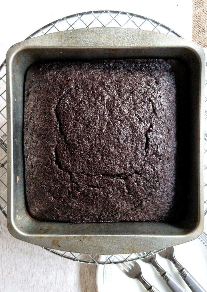 Chocolate devils food cake in a baking pan without a glaze