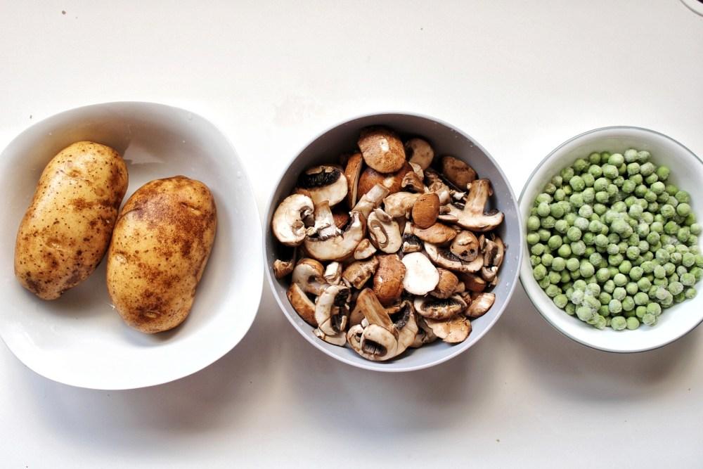 Russet potatoes, sliced mushrooms, and frozen green peas