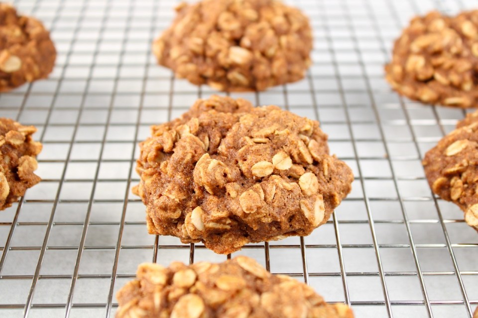 On a cooling rack, you can see a few cinnamon oatmeal cookies cooling down.