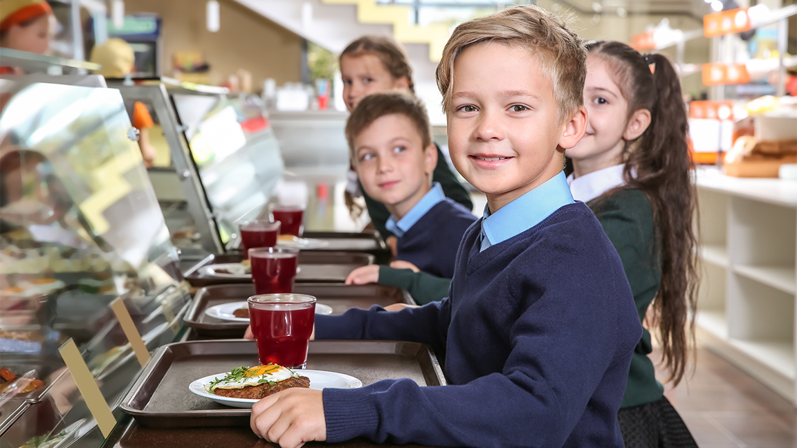 Children in a school cafeteria - where red meat has been banned in new york