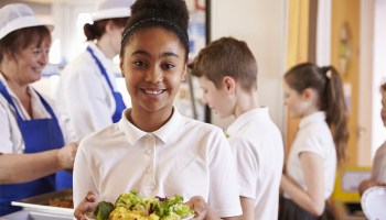 A child being served food at school