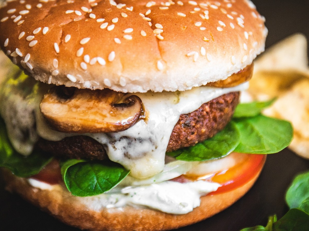 Vegan cheeseburger with melted cheese