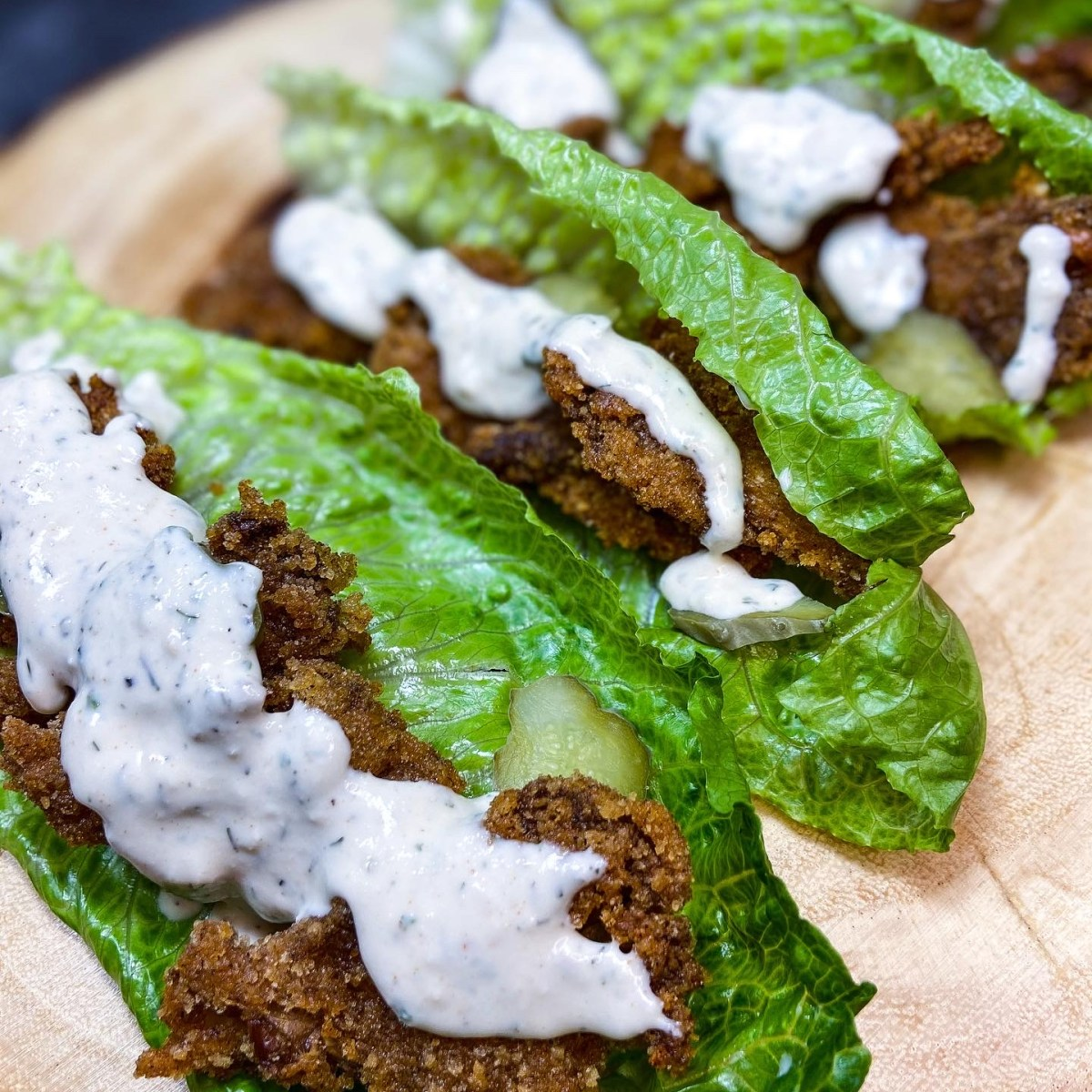 Southern fried chicken wraps with breaded, fried oyster mushrooms instead of chicken and ranch on top.