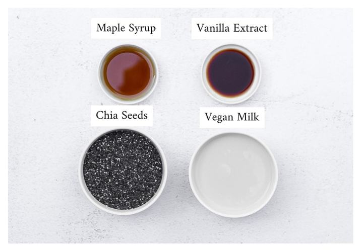 Labeled ingredients for chia seed pudding including maple syrup, vanilla syrup, chia seeds, and vegan milk