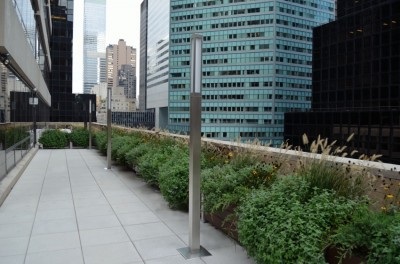 DeepStream Designs lightweight planter system, shown on a roof deck in midtown Manhattan, is made with maintenance free recycled plastic lumber: click for details