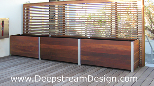 Click for more info on DeepStream's multi-section prefabricated modular wood garden planter with a wood screen wall.