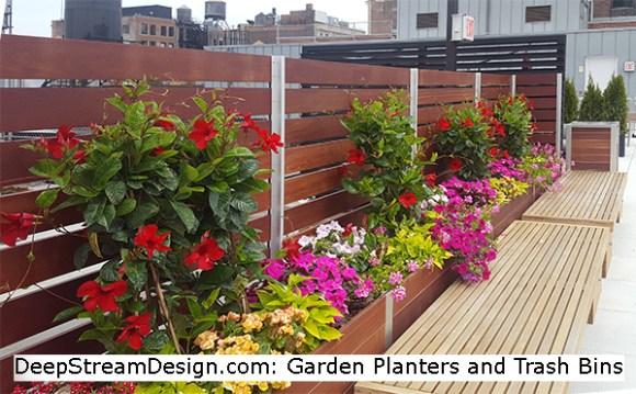lightweight planters by Deepstream Design incorporate a wooden privacy screen wall hiding rooftop utilities