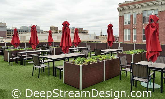 large rectangular planters growing produce on Fenway Stadium Strega deck