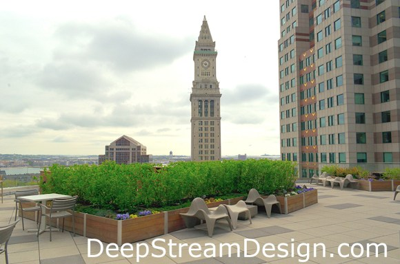 Lightweight modular custom wood planters make landscaping roof terraces possible as seen here atop a commercial building in Boston where they create outdoor dining and lounging spaces for tenants.
