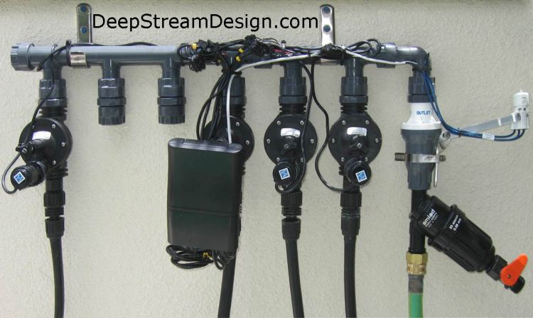 Automatic Drip Irrigation Manifold with Rain Sensor and 4 active zones.  Click pic to link to DripWorks website for more information.