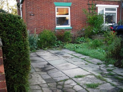 front garden overgrown and poorly paved