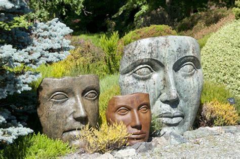 Garden statues of 3 faces as masks