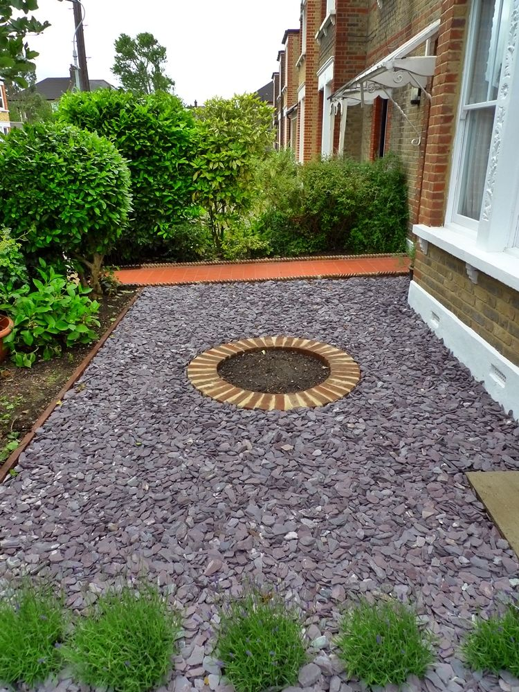 Front garden design with purple slate and evergreen planting. Formal style (but a bit dull!)