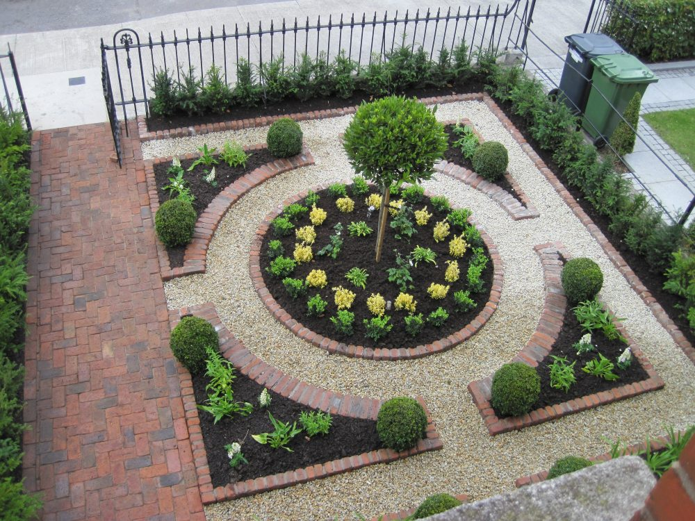 front garden parterre formal planting central circular border circle in a square garden.