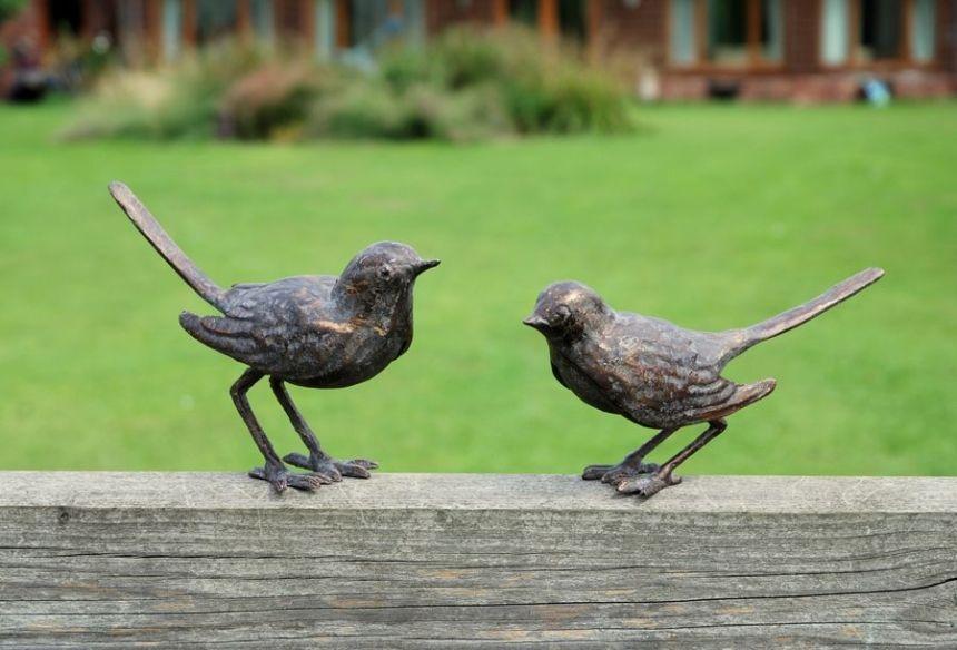 pair of bronze birds garden art