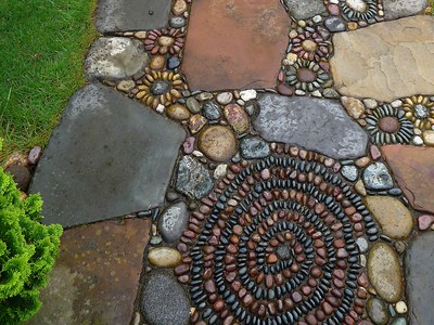Stone paving with pebble flowers