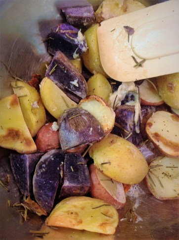 When the potatoes are done roasting, immediately toss them with the Garlic Rosemary paste. The heat of the potatoes will bring out more flavor in the garlic and rosemary